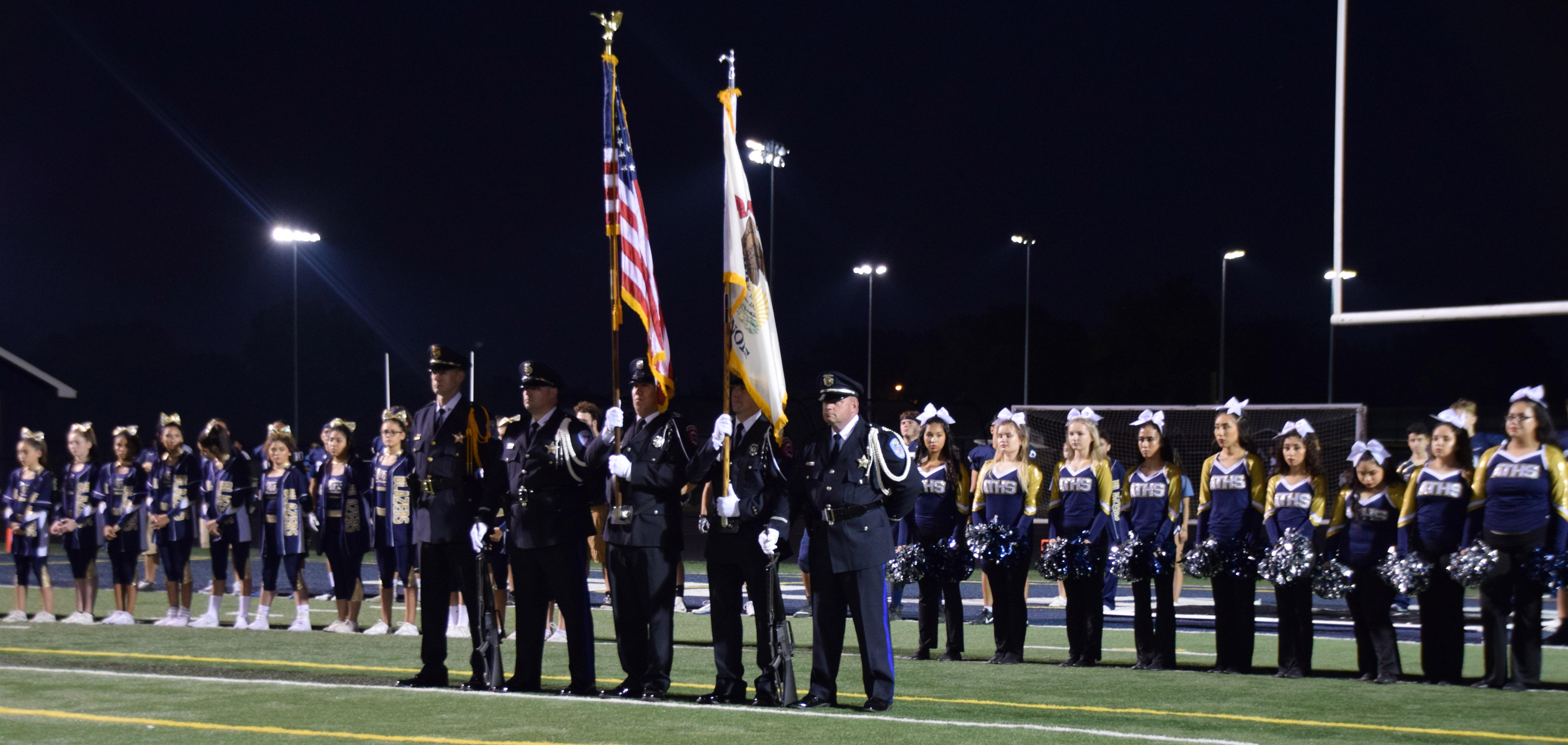 District 88 recognizes community leaders, first responders and veterans during crosstown football game
