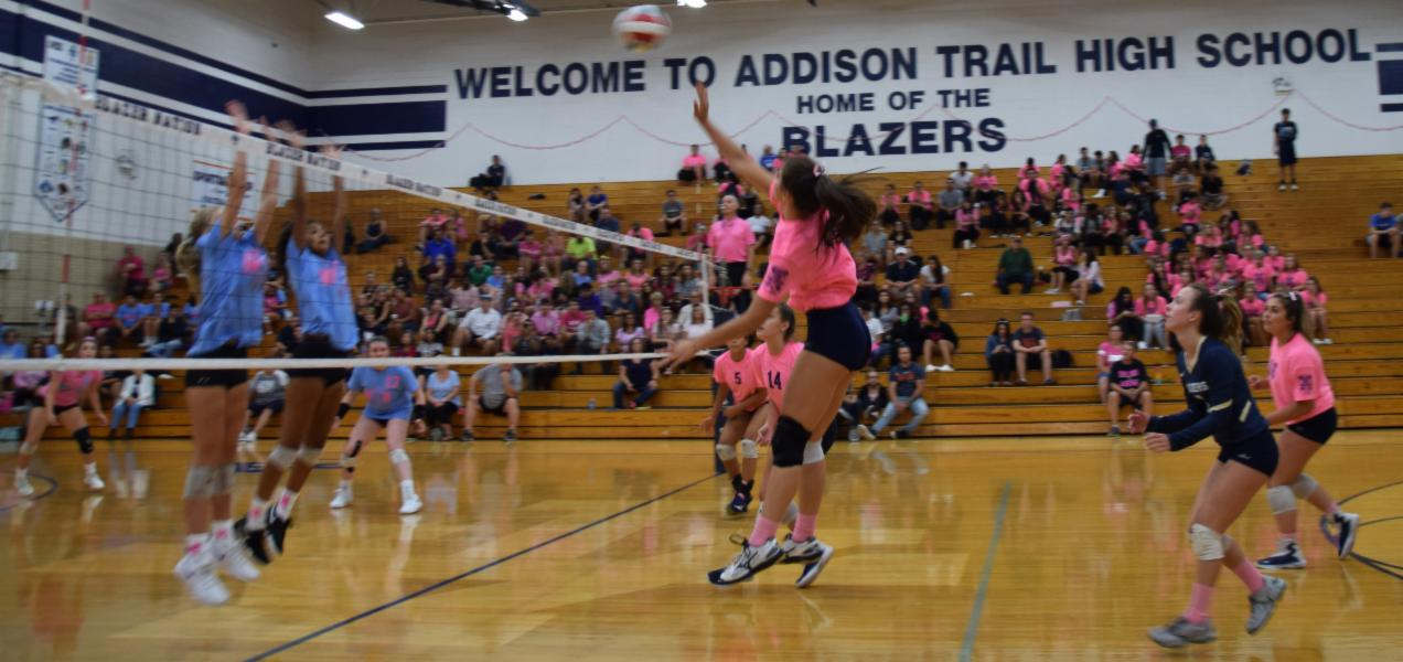Addison Trail and Willowbrook face off for a cause during District 88's annual Go Pink volleyball match