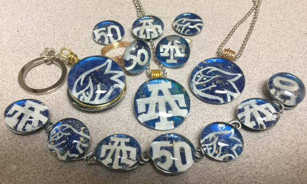 Celebrate Addison Trail's 50th anniversary in style with commemorative jewelry