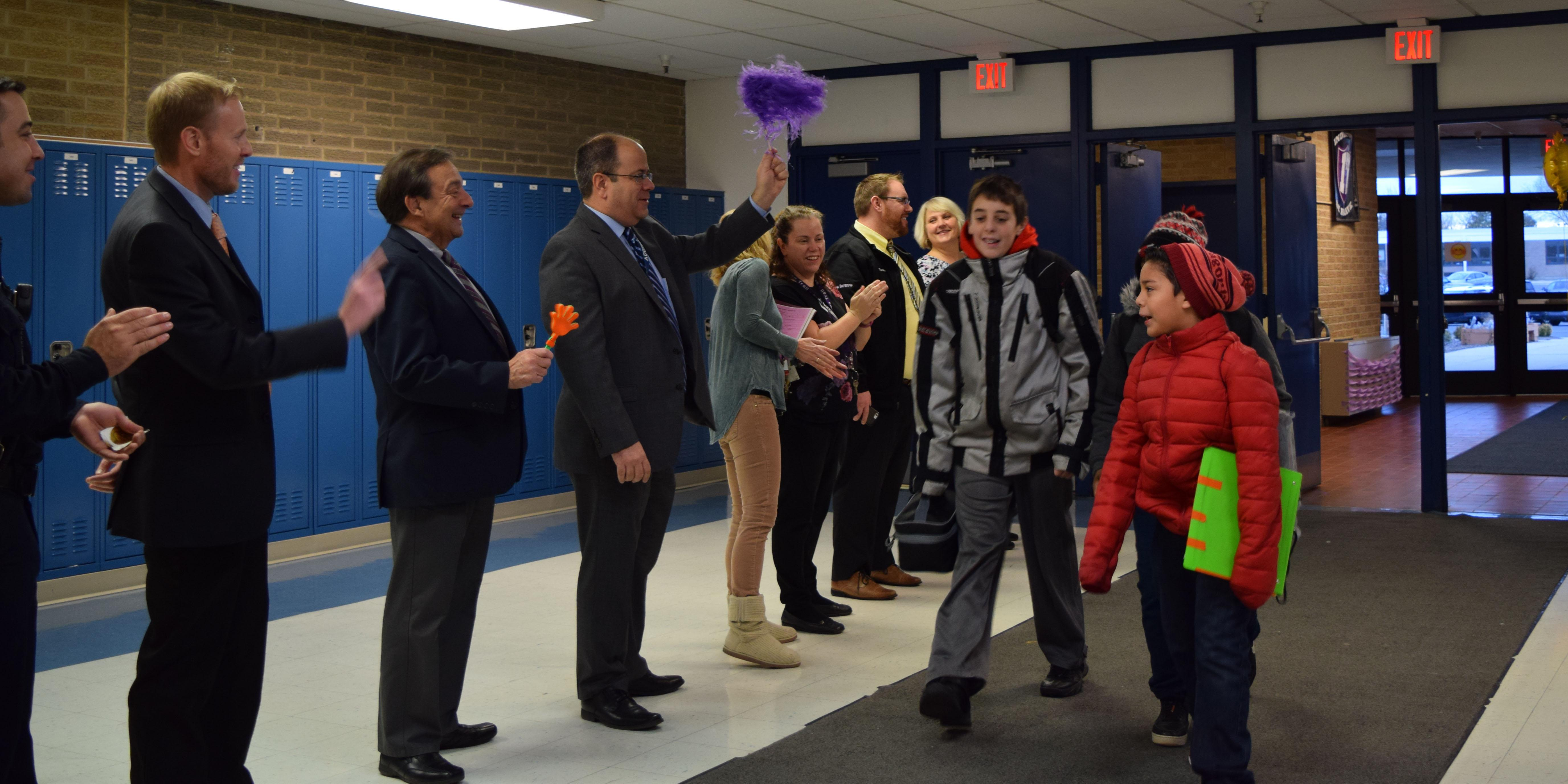 Addison Trail Principal participates in 'Kindness Tunnel' to welcome Indian Trail Junior High School students and celebrate Random Acts of Kindness Week